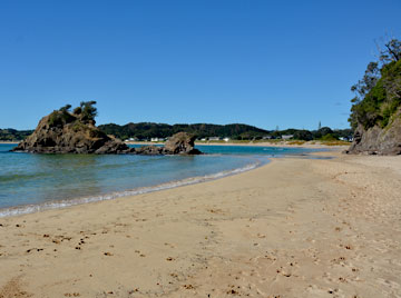 The golden sand beach at Matapouri Bay